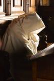 Monk with hood Stock Photo