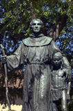 Monk and indian boy. Fr. Serra - catholic missionary - monument at mission San Fernando, California royalty free stock photography