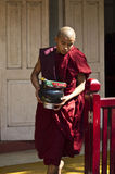 A monk and its offering Stock Images