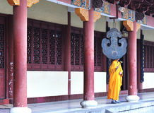 Monk knocking the bell Royalty Free Stock Photos
