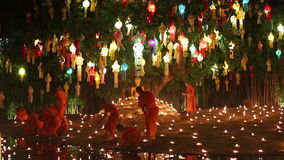 Monk light a candles to pray the Buddha. CHIANG MAI THAILAND - NOVEMBER 25 : Yee-Peng festival is an important culture in Thailand, Monk light a candles to pray stock footage