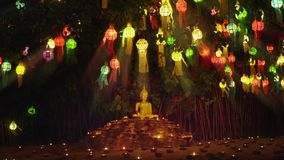 Monk light a candles to pray the Buddha in Temple, Chiang Mai,. Monk light a candles and lanterns to pray the Buddha in Temple, Chiang Mai, Thailand stock footage