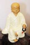 The monk. A little monk made of ceramic stock photo