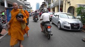 Monk and local people at Jalan Kuala Kangsar in morning.