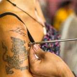 Monk makes traditional Yantra tattooing during Wai Kroo Master Day Ceremony in Bang Pra monastery stock image
