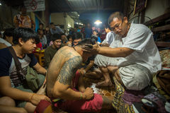 Monk makes traditional Yantra tattooing during Wai Kroo Master Day Ceremony in Bang Pra monastery Royalty Free Stock Image