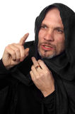 Monk or maybe sorcerer. In black cloack with hood Stock Image