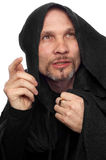 Monk or maybe sorcerer. In black clothing with hood Stock Photos