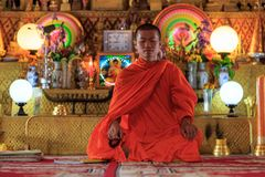 A monk meditating in the lotus position Royalty Free Stock Images