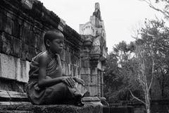 Monk boy meditate. In front fot the Royalty Free Stock Image