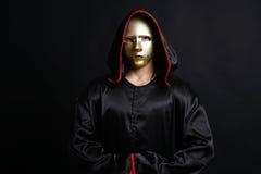 Monk mystical mask. In dark studio royalty free stock image