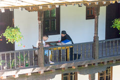 Monk and novice in the Troyan monastery in Bulgaria royalty free stock photos