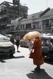 Monk in orange bangkok Stock Photo