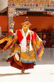 Monk performs a masked and costumed sacred dance of Tibetan Budd royalty free stock images