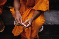 Monk- Phnom Penh, Cambodia. Monk draped in saffron at Wat near downtown Phnom Penh, Cambodia Stock Images