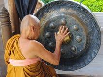 Monk plays a singing bowl Royalty Free Stock Photos