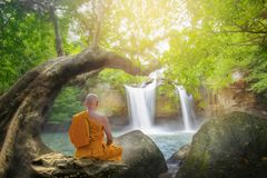 Monk practice meditation. At haew suwat waterfall in thailand,Khao Yai national park ,Thailand royalty free stock photos