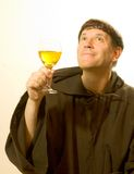 The Monk Praises the Wine. Photo of a monk looking enjoying a good glass of wine stock image