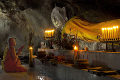 Monk pray in cave Stock Image