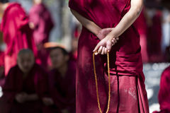Monk with prayer beads royalty free stock photography