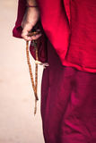 Monk with prayer beads Royalty Free Stock Image