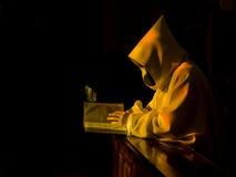 Monk in prayer Stock Photos