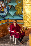 Monk at the prayer wheel Royalty Free Stock Image