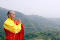 The monk in praying. In the mountain depths, the monk in praying royalty free stock image