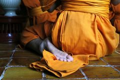 Monk praying. Detail of feet of monk during praying in buddhist temple Stock Photography