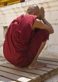 A monk praying Stock Photo