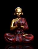 Monk Praying Over Black Stock Photography