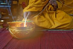 A monk prays with the holy water in the Buddhists Auspicious ceremony. royalty free stock photos