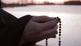 Hands touch beads, sunset stock video footage