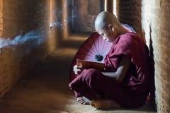 Monk reading book stock photo