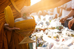 Monk receiving food and items offering Stock Photography