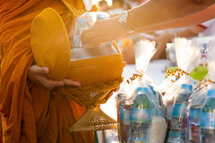 Monk receiving food and items offering from people Royalty Free Stock Image
