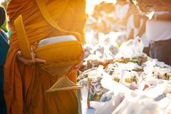 Monk receiving food and items offering from people Stock Images
