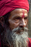 The monk with a red turban. Portrait of a sadhu wearing a red turban Royalty Free Stock Images