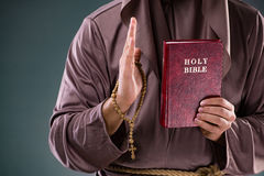 The monk in religious concept on gray background Stock Photo