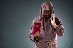 The monk in religious concept on gray background Stock Images