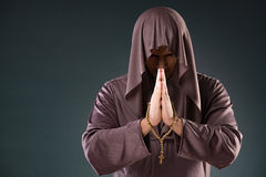 The monk in religious concept on gray background Royalty Free Stock Images