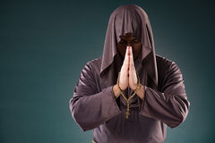The monk in religious concept on gray background Stock Photography