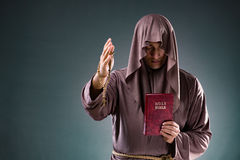The monk in religious concept on gray background Royalty Free Stock Image