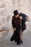 The monk returning to the monastery Stock Photo