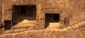 Monk Rock Dwellings. Rock dwellings at Kanheri Caves in Sanjay Ghandi National Park, Mumbai Royalty Free Stock Photo