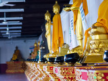 Monk's alms bowl. And Buddha statue in thai temple stock images
