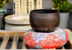 Monk's bowl for donations on a silk cushion. Kiyomizu-dera, Kyoto, Japan stock photography