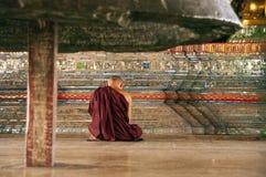 Monk's prayer, Shwedagon Paya, Yangoon royalty free stock photos