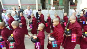 Monk`s procession in monastery, Myanmar. Amarapura, Myanmar-13 December, 2015. Daily meal procession of over the thousand monks at the country`s largest stock video footage
