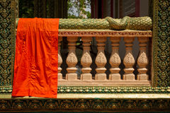 A monk's robe in a riverside temple of Kampot, Cambodia. Riverside temple of Kampot, Cambodia Stock Photography